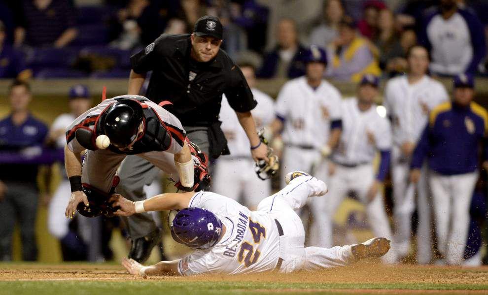 Jordan Romero delivers twice, including a winning hit in the 12th inning, as LSU tops Cincinnati 6-5 in its season opener _lowres