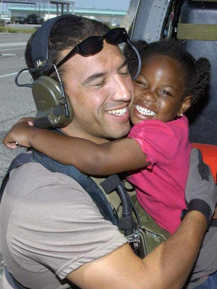 Air Force Times report: Master Sgt. hopes to find out what became of the little girl he helped rescue in Hurricane Katrina's wake, caught in photo _lowres