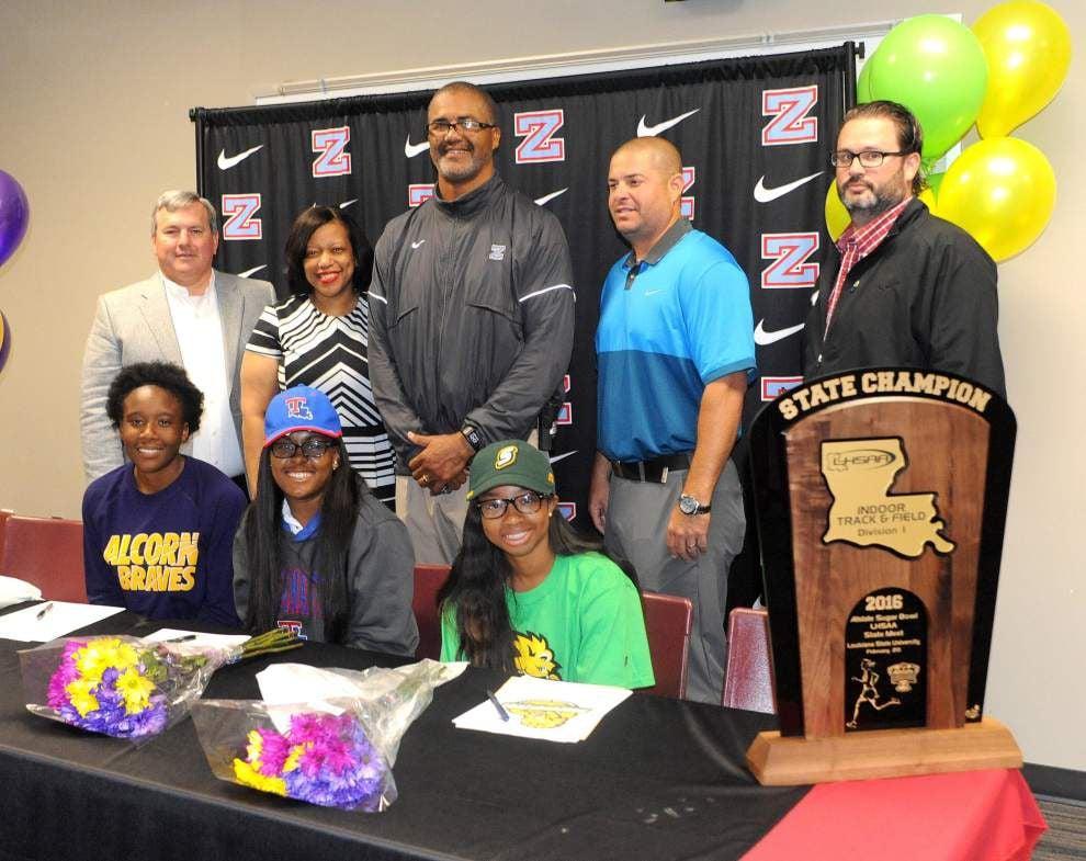 High school sprinters, hurdlers sign track deals _lowres