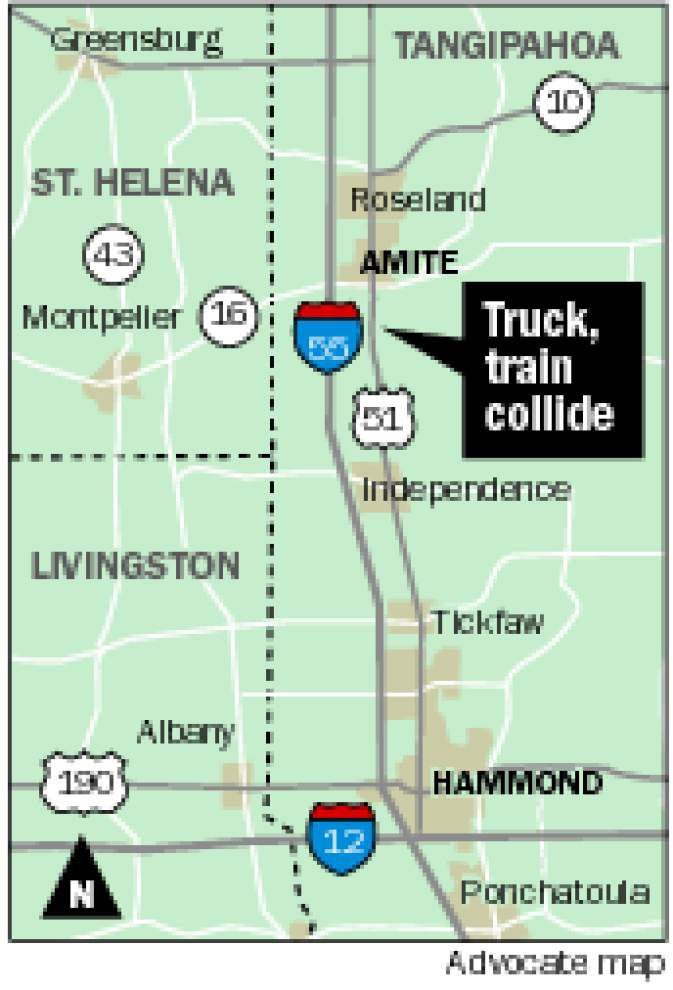 Truck driver hospitalized after collision with Amtrak train _lowres