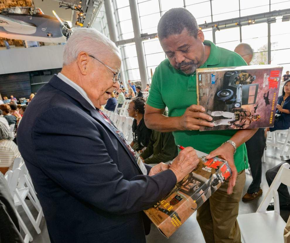 WWII Museum honors Tuskegee Airmen, adds restored P-51 plane to collection _lowres