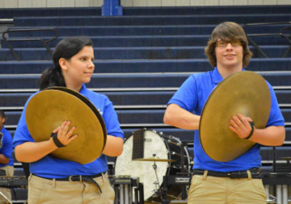 Band ignites gym with preview of new show _lowres