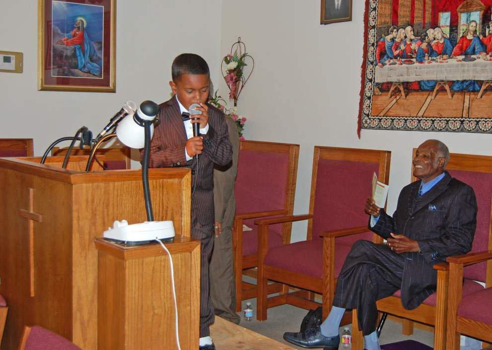Child preacher at St. Luke Baptist Church gives sermons despite not yet learning how to read _lowres