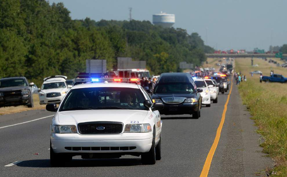 Photos: Officers salute fallen Shreveport officer, honor him as his body returned to Ascension Parish _lowres