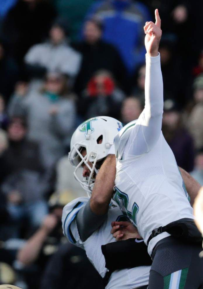 Tulane kicker Andrew DiRocco savors his game-winning field goal against Army; Black Knights carry French and American flags onto field before game _lowres