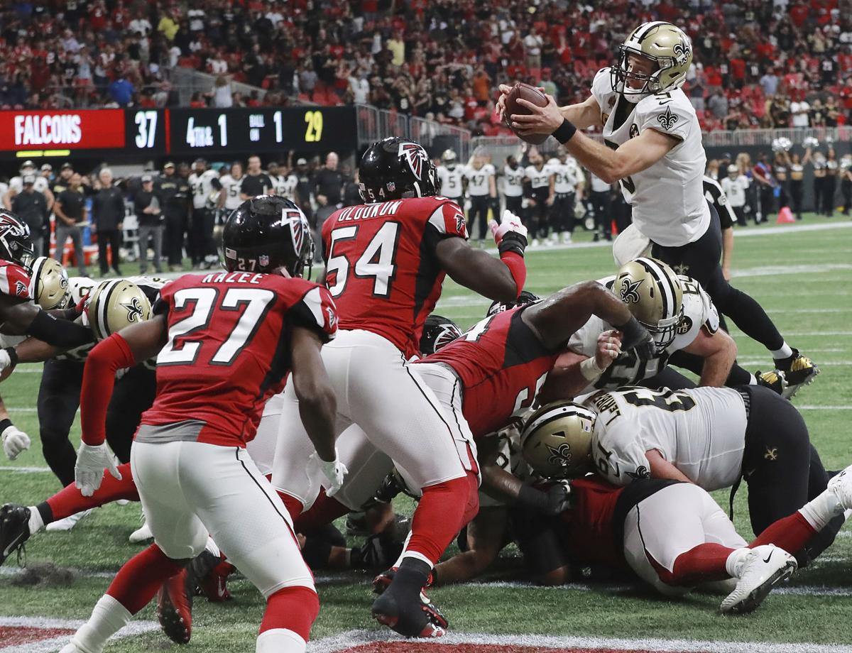 New Orleans Saints quarterback Drew Brees goes over the top for the winning  touchdown in overtime to beat the Atlanta Falcons 43-37 in an NFL football  game c5b9a4bb3