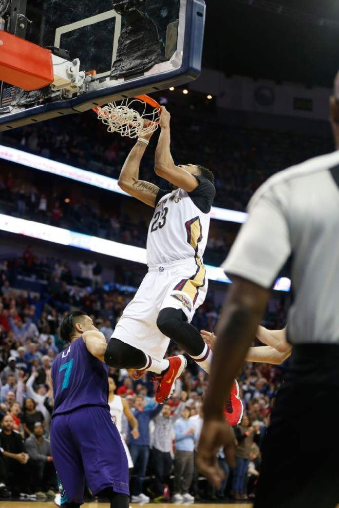 New Orleans Pelicans star Anthony Davis goes from winning dunk to lifting weights _lowres