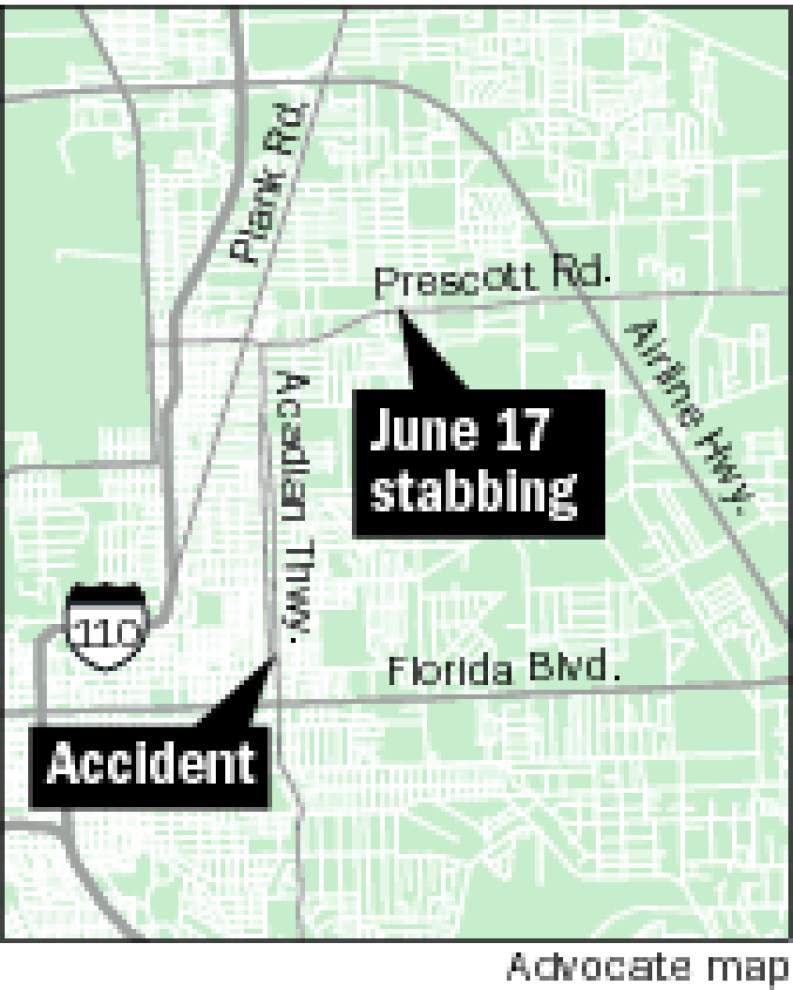 Coroner says passenger in early Sunday traffic accident died from stab wounds _lowres