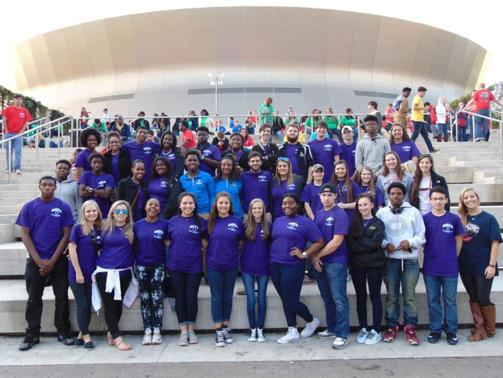 St. Amant's DECA group enjoys Pelicans' win _lowres
