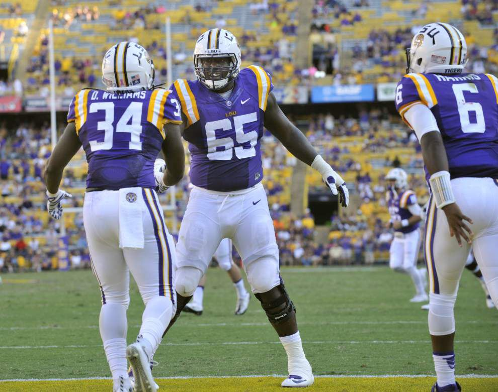 LSU players Jerald Hawkins, DeSean Smith battling injuries; Les Miles hopeful they'll return to practice soon _lowres