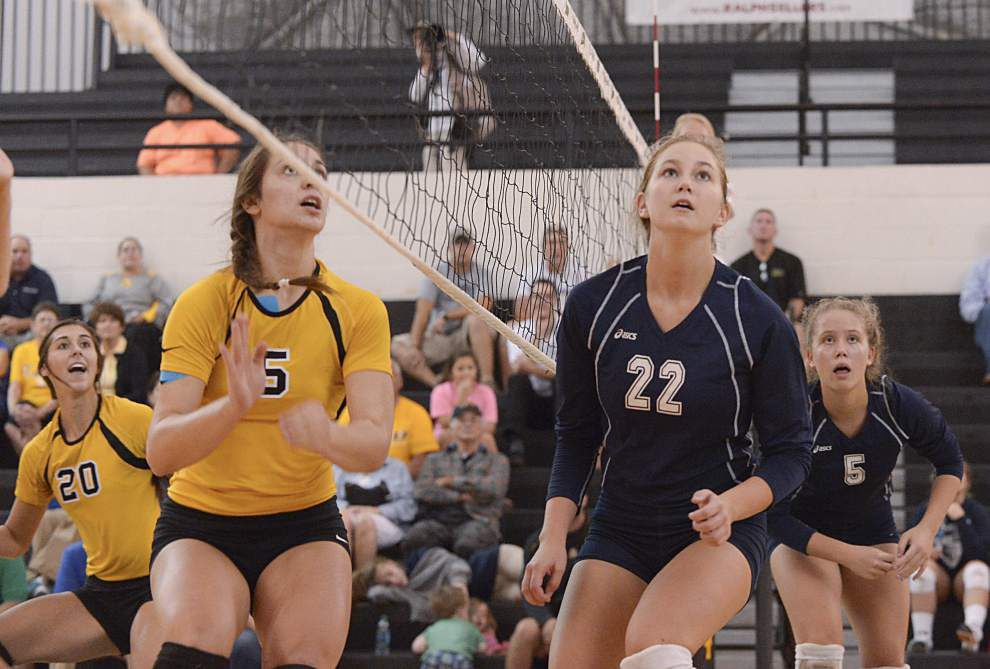 St. Amant sisters, working to find chemistry on the volleyball court _lowres