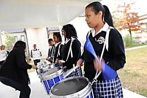 High school marching bands learn classic New Orleans songs