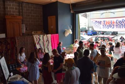 Hundreds pack Magazine Merchant House for 'boozy bake sale' to support abortion rights