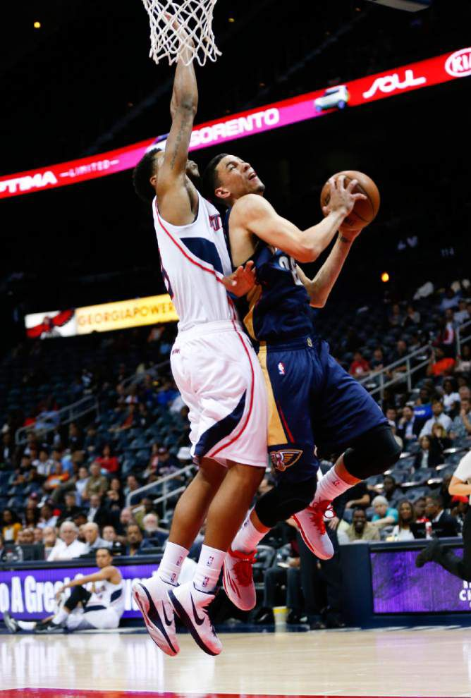 Injured Pelicans get more time on court in loss to Hawks _lowres
