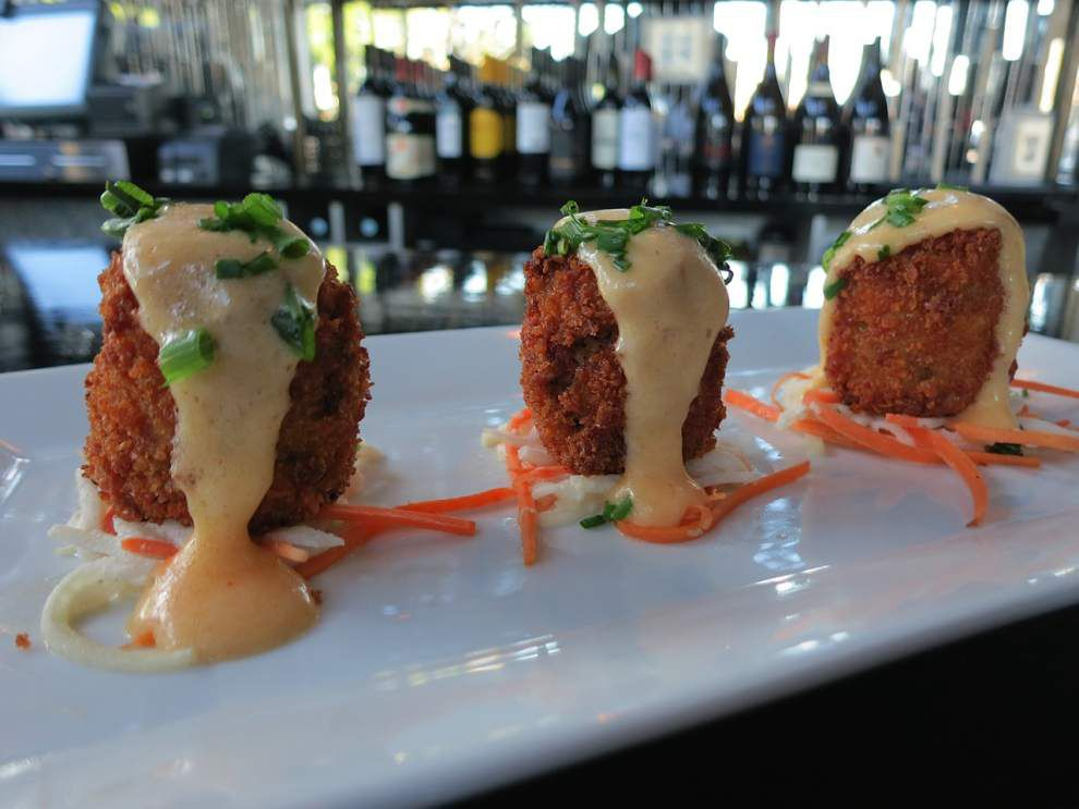 Digging In: New twists add sparkle to Cava's crab cakes _lowres
