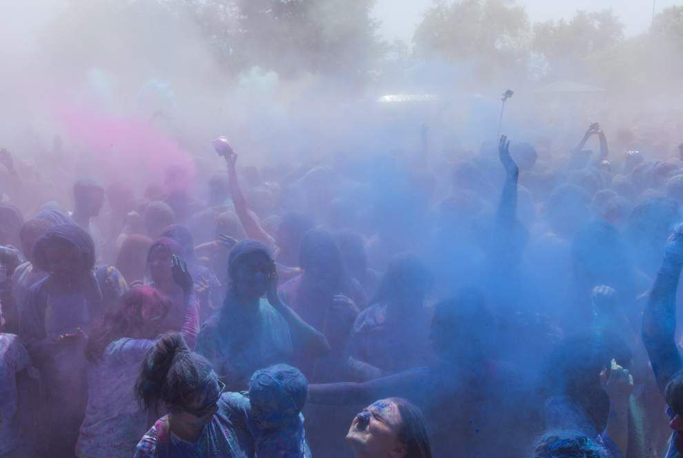 Colorful powder fills the air, and covers people, at Lafayette Holi Festival _lowres