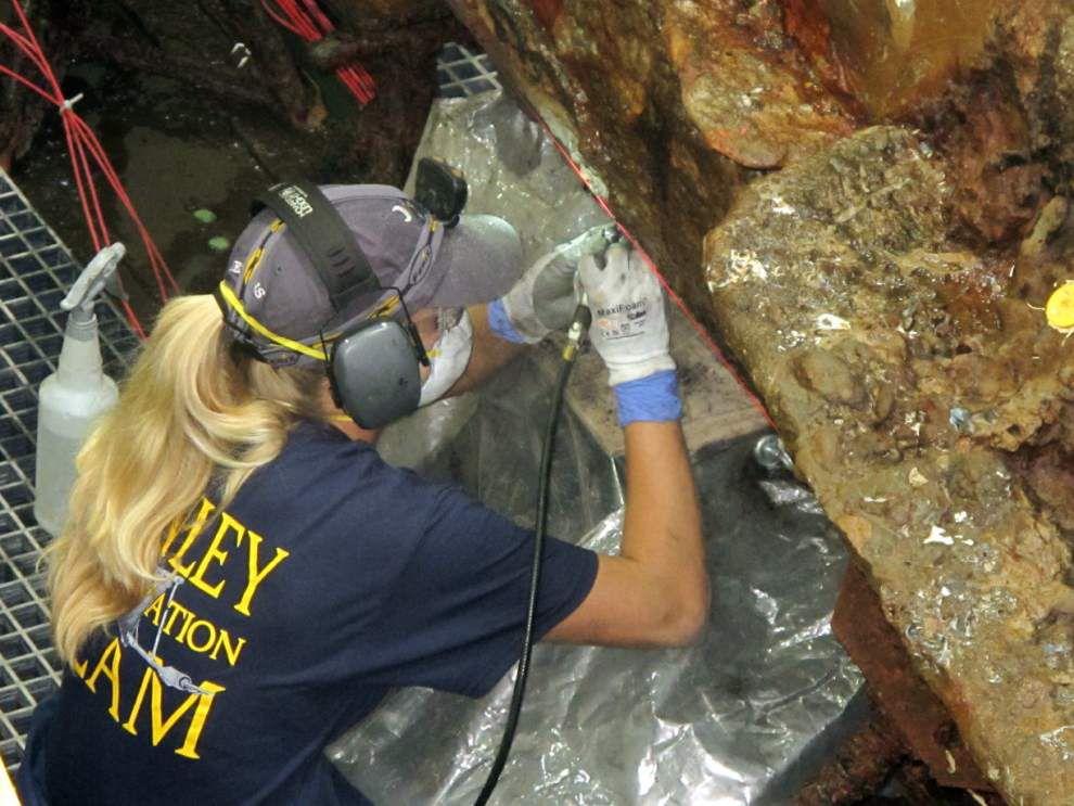 Scientists remove encrustation on Confederate sub _lowres