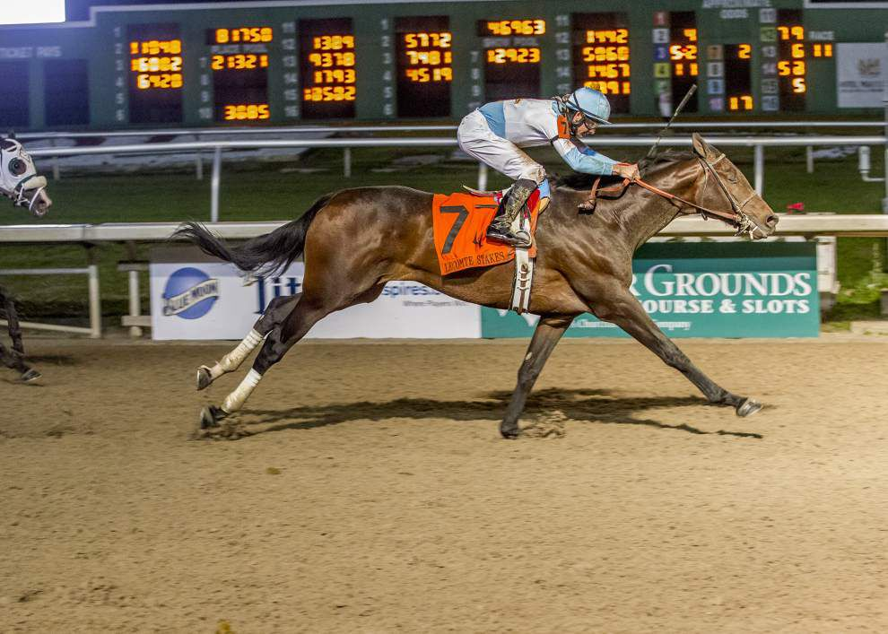 Benson horses finish 1-2 in Lecomte Stakes, with Mo Tom claiming the win at the Fair Grounds _lowres