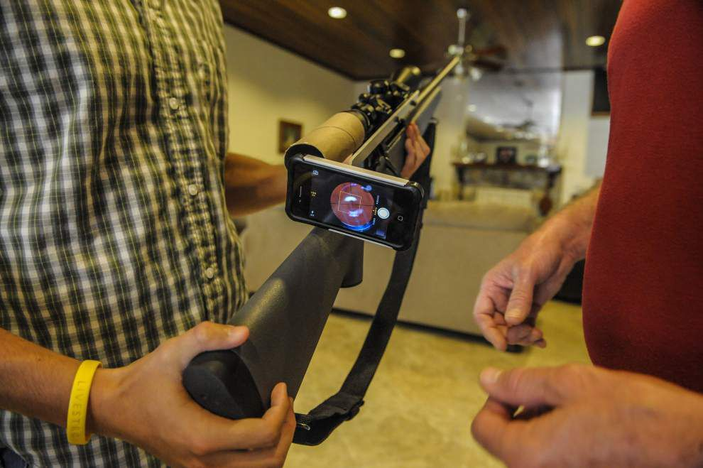 Father's Day 2014: Son's ingenuity lets his blind father enjoy hunting _lowres