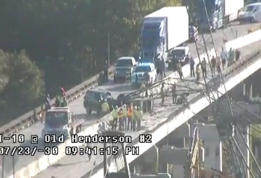 Crane falls on SUV at end of I-10 bridge in St  Martin