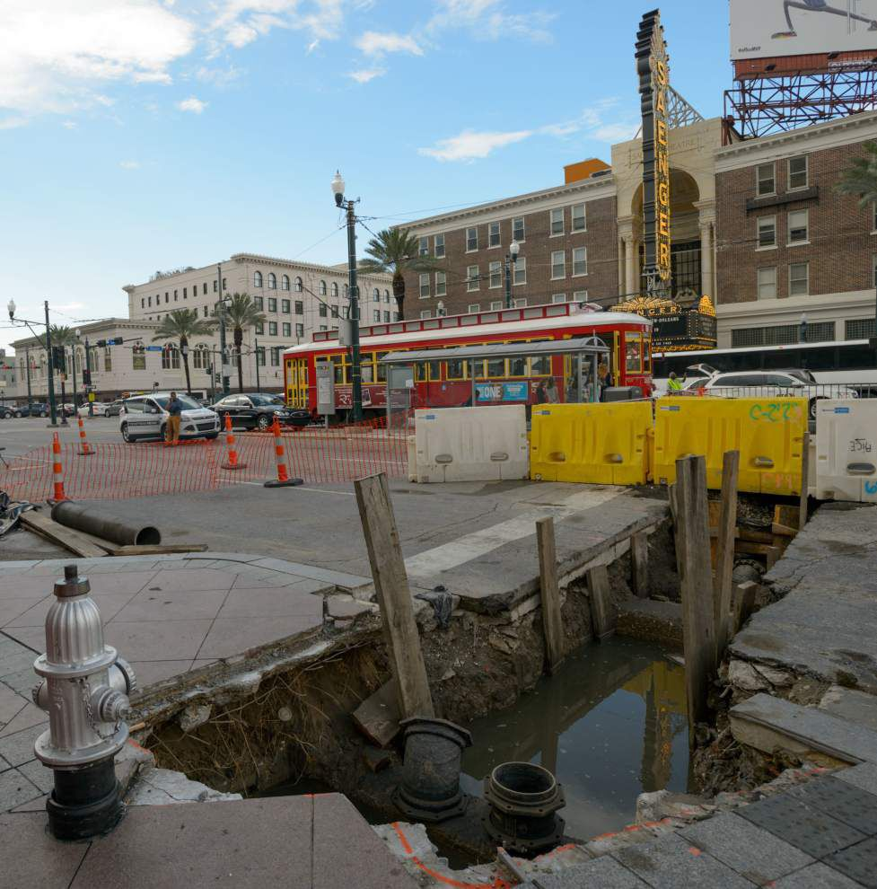 Sinkhole forms on Canal Street alongside ongoing construction, snarls traffic before temporary fix _lowres