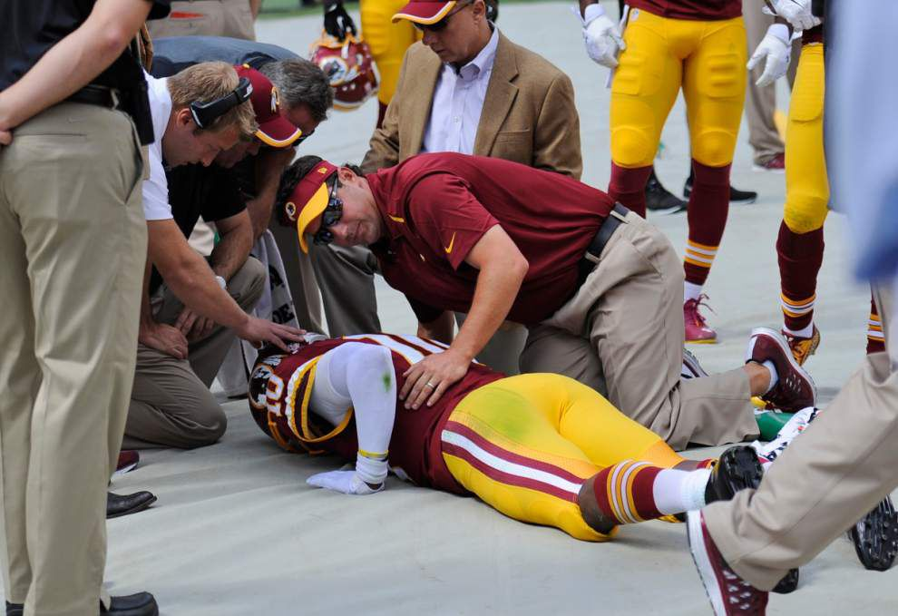 Redskins QB RG3 dislocates ankle in 41-10 romp _lowres