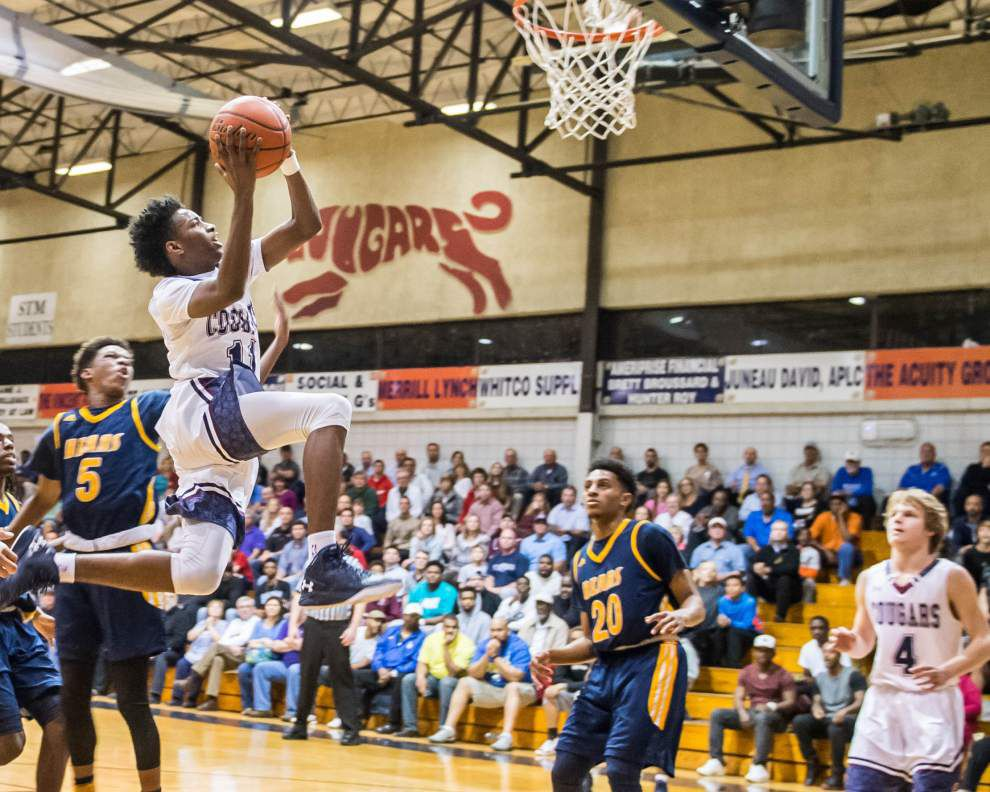 Boys basketball playoffs: After trailing Carencro by three at halftime, St. Thomas More wins by 20 _lowres