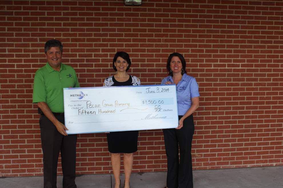 Company donates to Pecan Grove _lowres