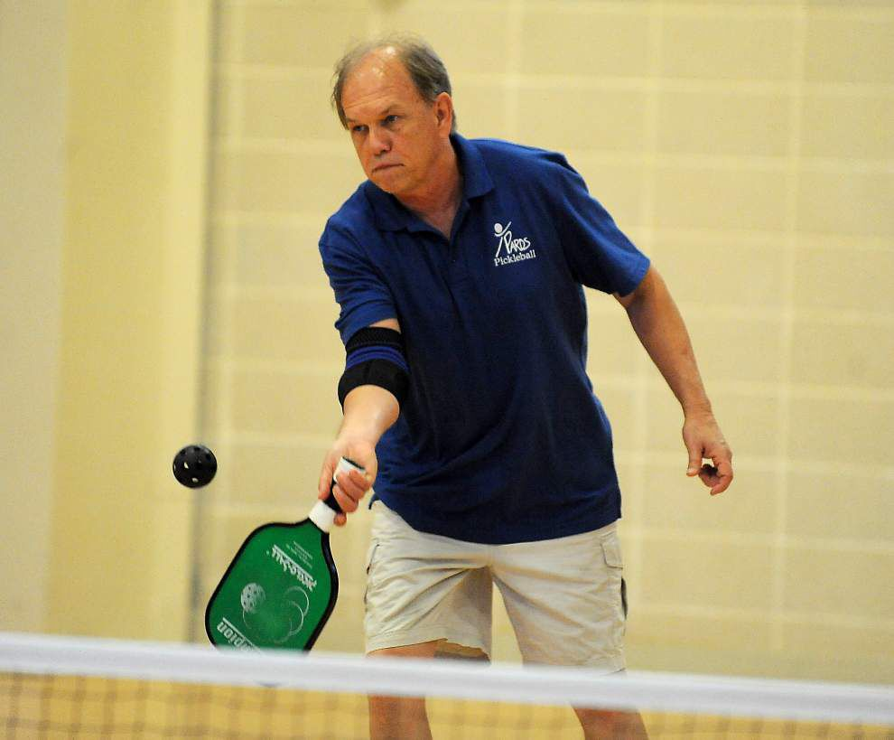 Sport, gaining popularity, combines badminton and pingpong _lowres