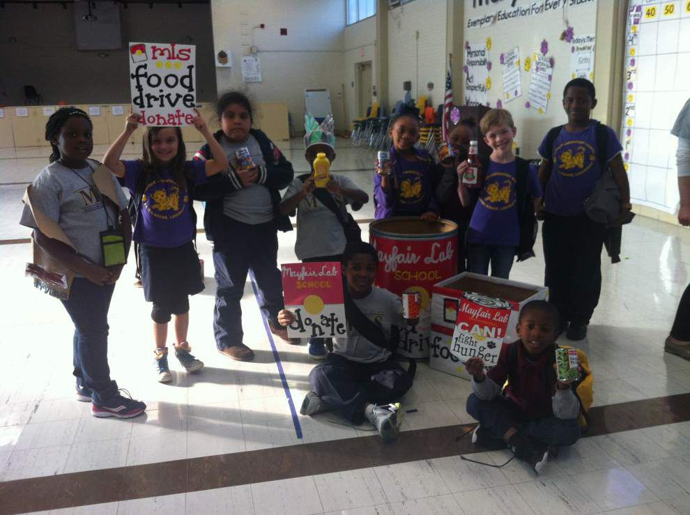 School makes hefty food pantry donation _lowres