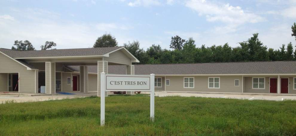 Residents show off their new C'est Tres Bon! apartments _lowres