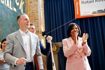 eBay president/CEO Devin Wenig and Mayor-President Sharon Weston Broome
