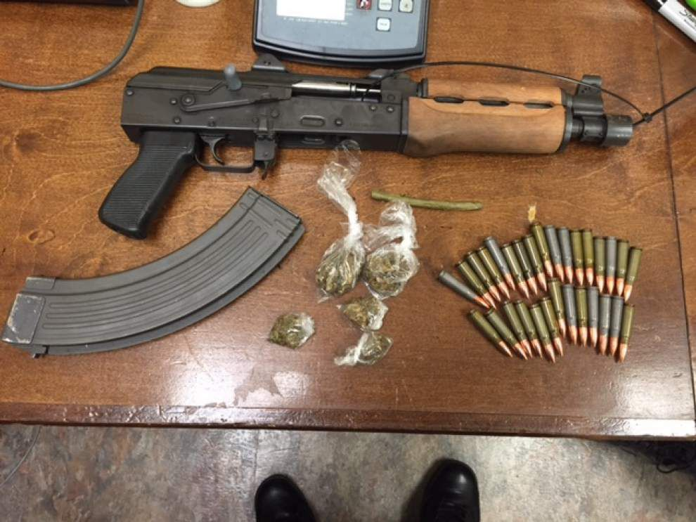 Man flees during traffic stop, police find rifle and marijuana in vehicle, Sheriff's Office reports _lowres