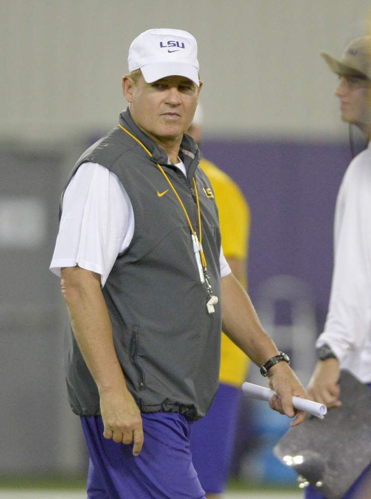 LSU coach Les Miles wouldn't mind seeing basketball phenom Ben Simmons around the goal line _lowres