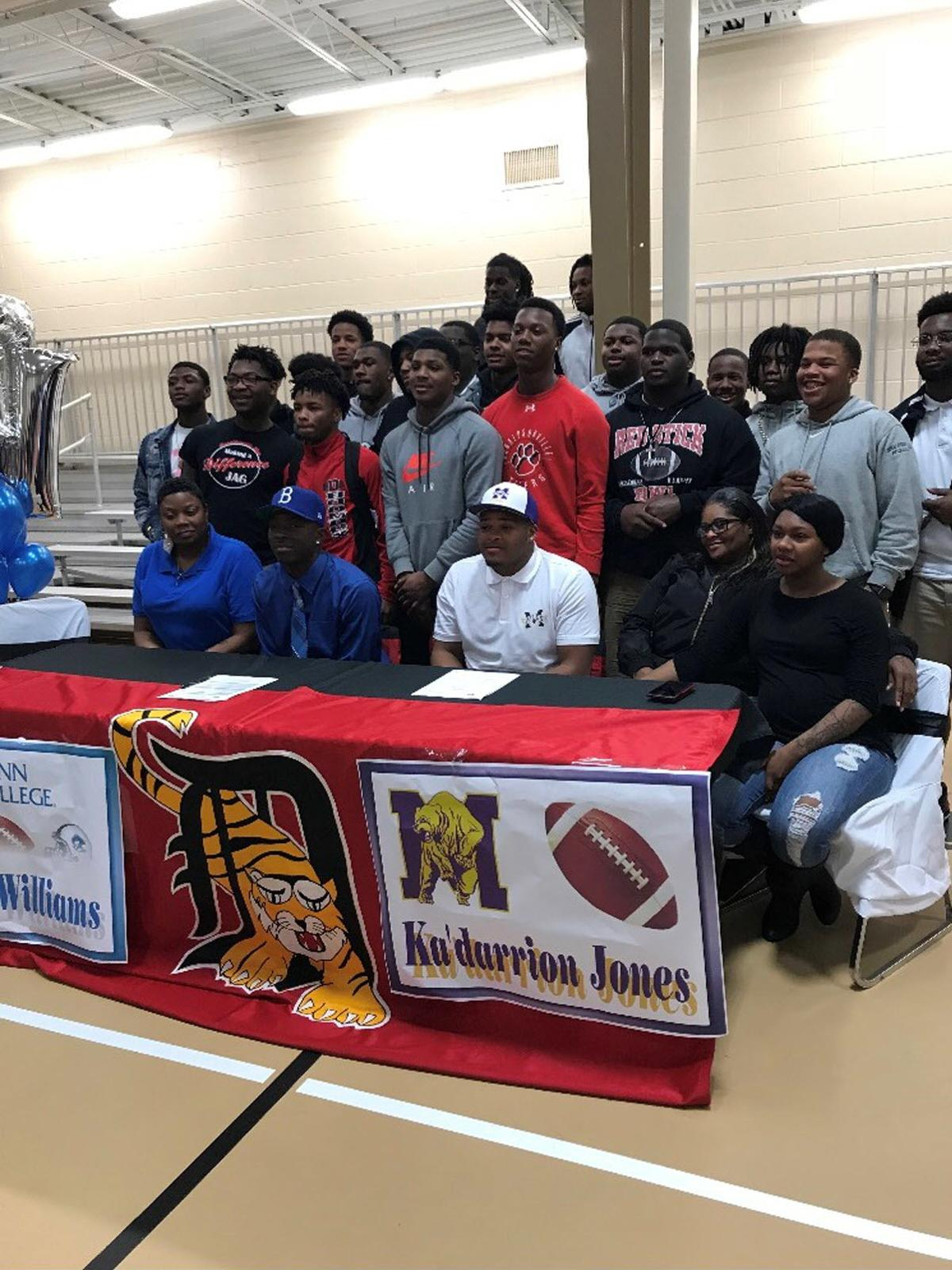 donaldsonville high football players sign letters of intent during