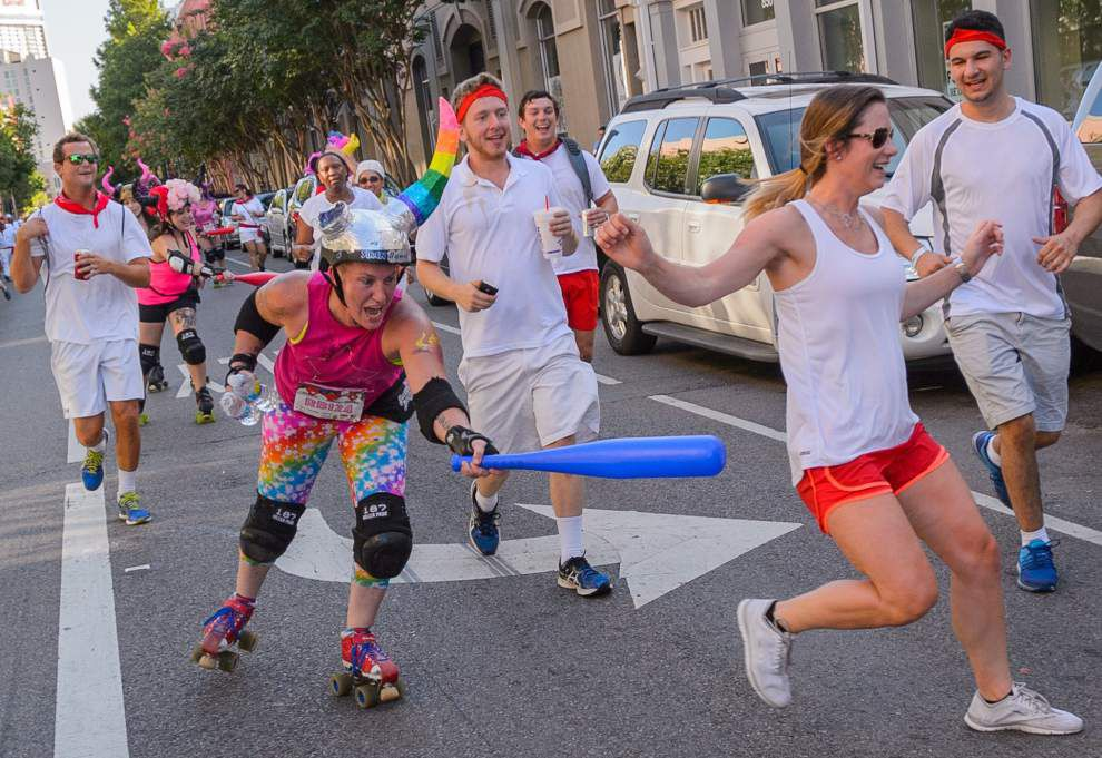 Photos: New Orleans runners duck and dodge bulls during annual Running of the Bulls _lowres