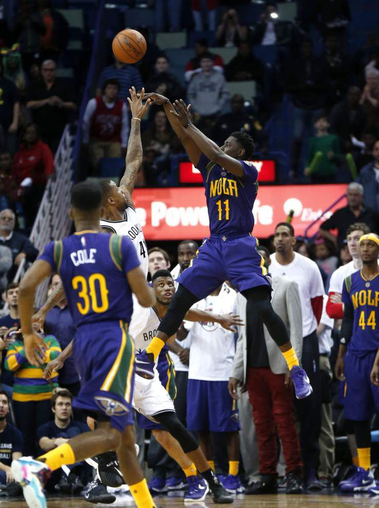 Jrue Holiday's late basket helps Pelicans outlast Nets _lowres
