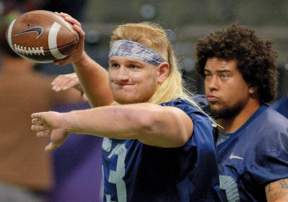 Nevada defensive end Brock Hekking loves Brian Bosworth haircut, playing style _lowres