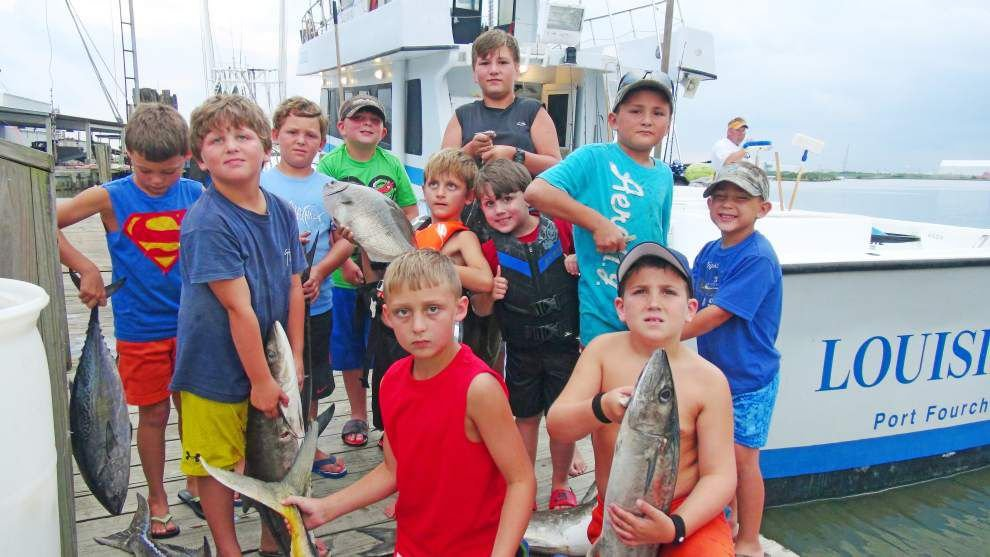 Charterboat captain Ed Pitre teaches kids about deep sea fishing _lowres