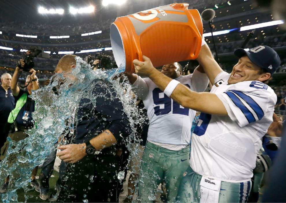 NFL roundup: Tony Romo sets Cowboys record in thrashing Colts _lowres