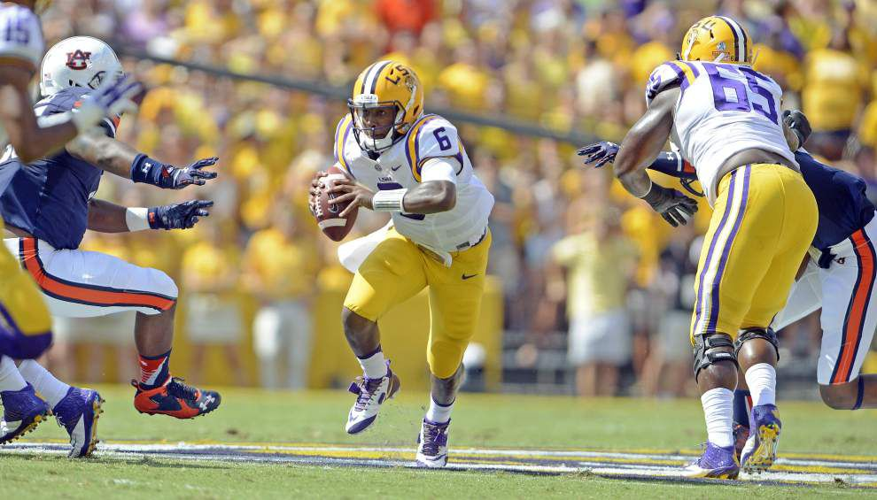 A game manager and running threat, LSU QB Brandon Harris doing more damage on the ground than in the air _lowres
