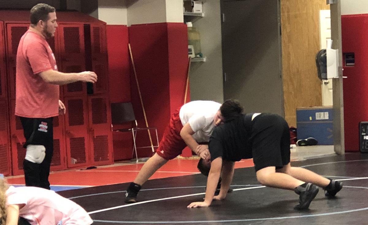 Coach JP Pierre gives instruction to Stallion wrestlers.JPG