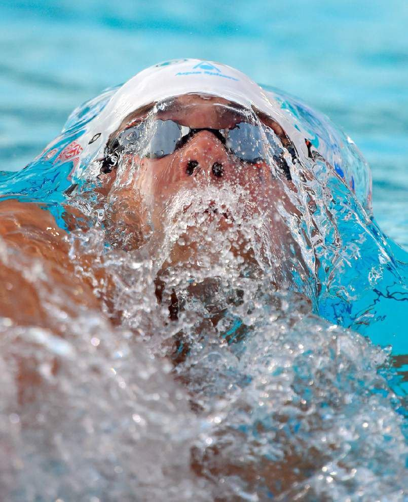 Michael Phelps dealing with defeat in comeback _lowres
