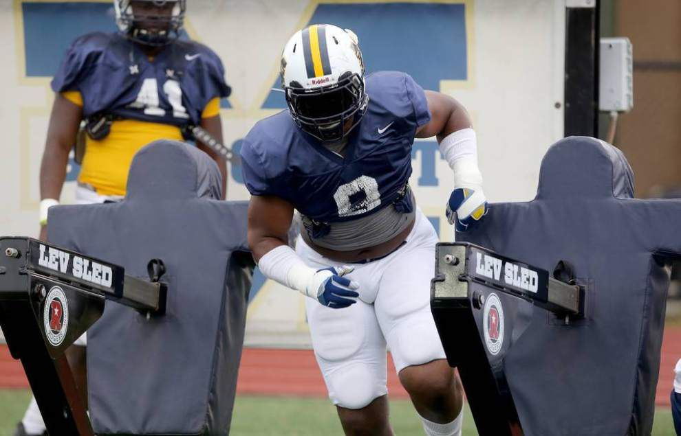 Sun Herald: Louisiana, LSU calling to Gulf Coast defensive end Isaiah Buggs; is he listening? _lowres