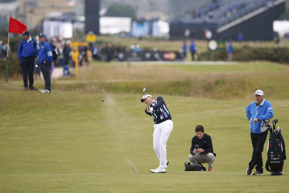 Tiger awaits St. Andrews, insists he's not 'buried and done' at British Open _lowres