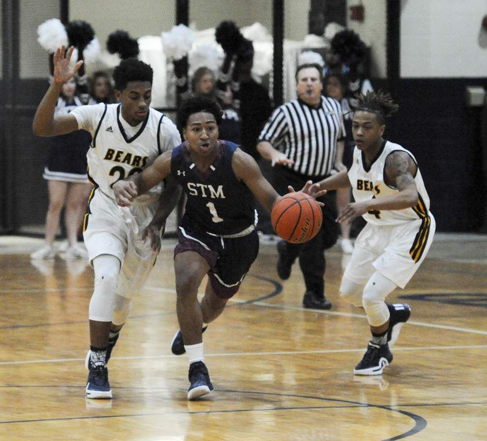 Trevor Begue's 23 points, hustle spark St. Thomas More win over Carencro _lowres