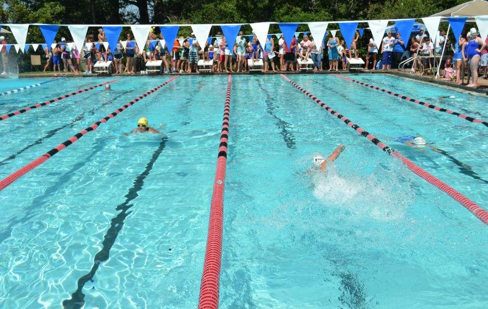 Pelican swim team wins division title _lowres