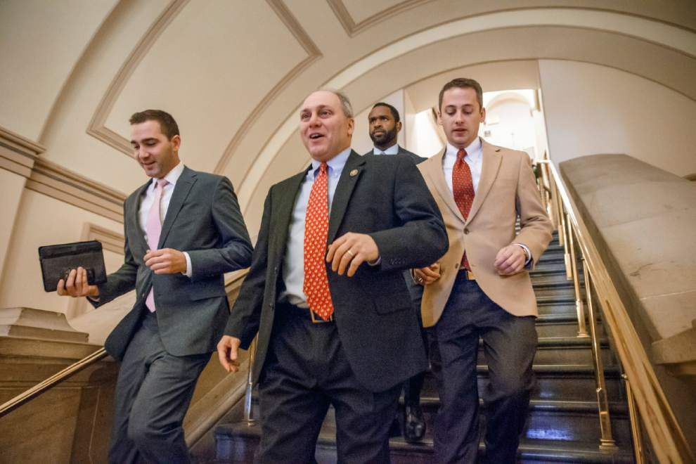 Group turns out to protest U.S. Rep. Steve Scalise at private appearance in Washington _lowres