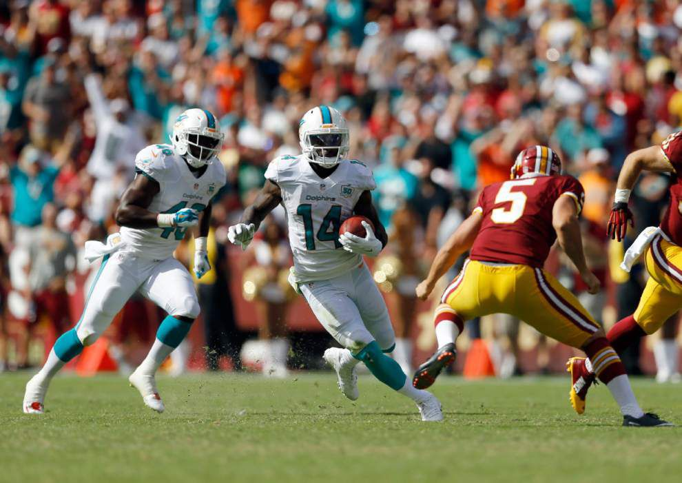 Report: Ex-LSU Tiger Jarvis Landry money on the field, says childhood struggles made him financially responsible off the field _lowres