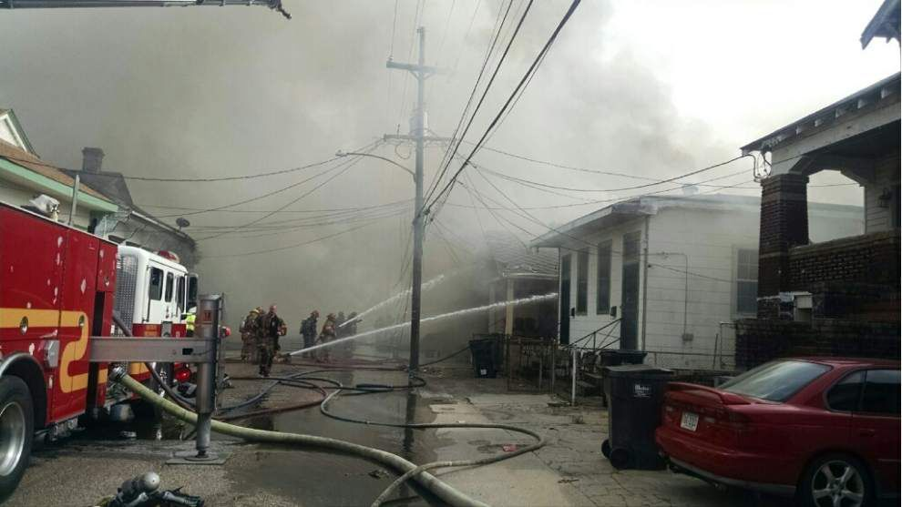 Video: Raging fire destroys home, damages two others on Marigny Street Wednesday _lowres
